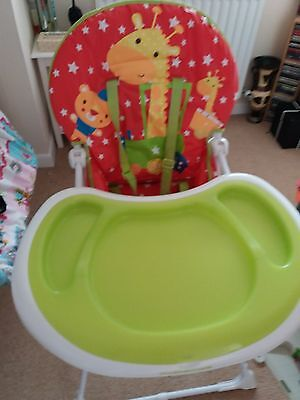 red little circus theme highchair lovely condition .paddded seat .easy clean .