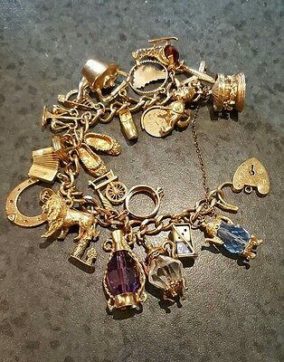 Heavy 9ct Yellow Gold Charm Bracelet with 23 Charms