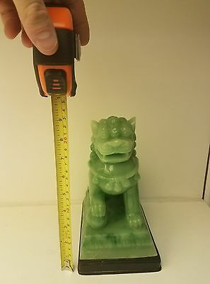 Fo dog statue weight over 6 pounds . not sure material