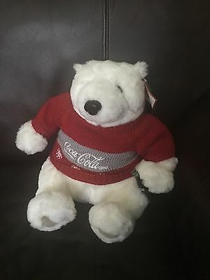 Coca cola plush bear with coke bottle.  Great condition. No smoking home.