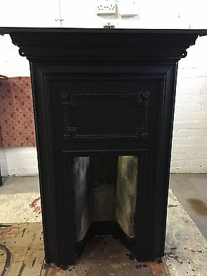 Restored Victorian cast iron fireplace