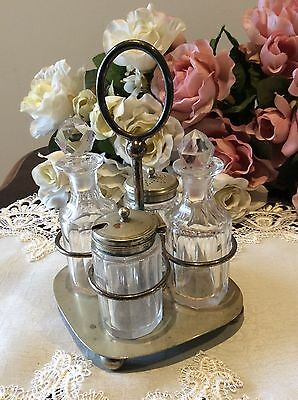 Silver Plated Cruet Holder With Original Containers.