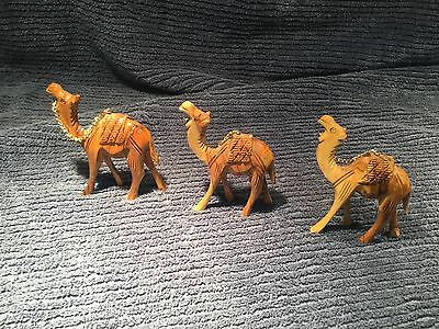 Three Hand Carved Wooden Camels