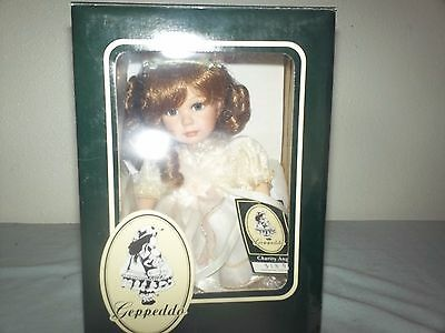 New In Box Geppeddo Charity Angel Doll Porcelain face hands legs with tags