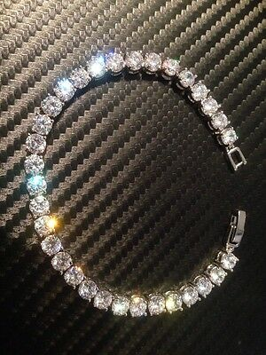 platinum bracelet with 32 synthetic diamonds stunning set on a round link mount