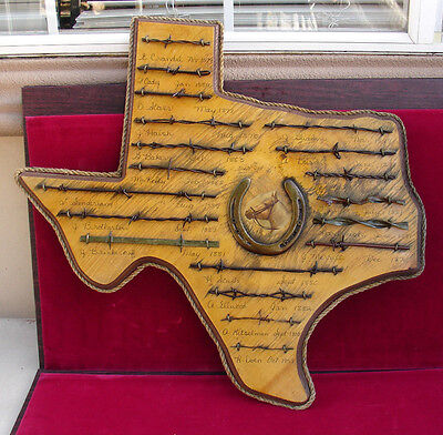vintage antique barb wire samples on wood Texas map plague