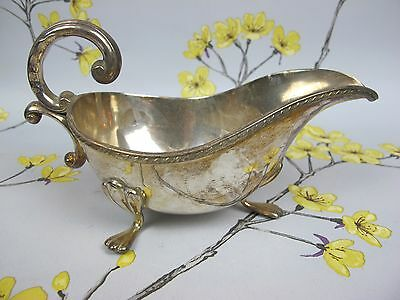 An attractive and decorative vintage silver plated SAUCE ~ GRAVY SERVING BOAT.