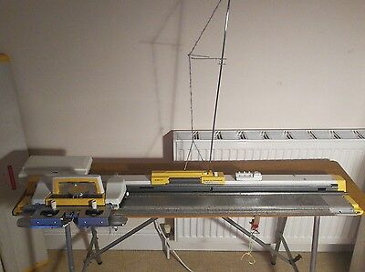 knitmaster knitting machine with accessory box and instruction book