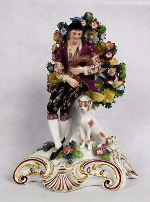 A Fine Edme Samson in the Chelsea Style Bocage Figurine of a Musician with a Dog