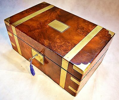 A 1904 Walnut Campaign Writing Slope with Secret Drawers & two Locks with Keys