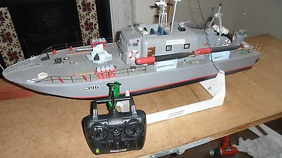 A radio controlled Perkasa Vosper MTB torpedo boat, with 2 channel hand set.