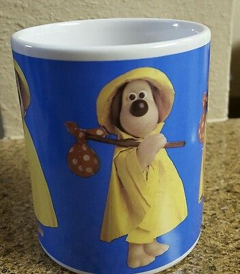 Coffee Mug of Grommet from Wallace and Grommet in a raincoat-Collectible!