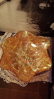 A gorgeous large Vintage orange lustre Carnival glass bowl with ruffled edge
