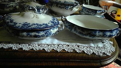 Two medium blue and white tureens in bisto dove pattern