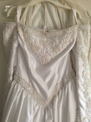 Brand new with tags long sleeved Demetrios wedding dress size 14