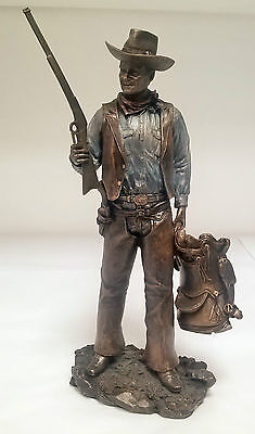 John Wayne Standing with gun and saddle Figure 60349