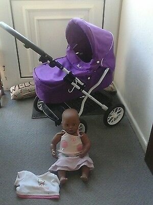 lovely silver cross dolls pram with baby annabell doll