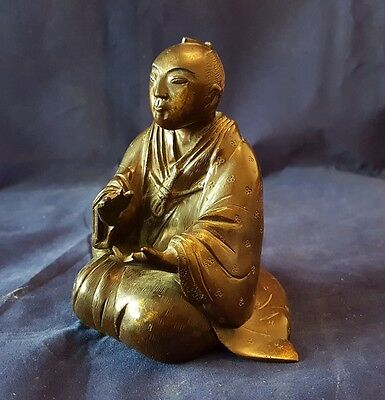 A Japanese Bronze seated figure. Probably Meiji Period (1890s) approx 110mm tall