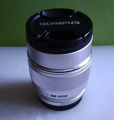 AS new … Olympus 75mm f1.8 - Silver + Lens hood + UV filter
