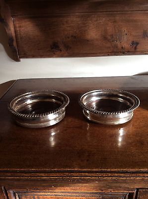 A Pair Of Old Silver Plated Wine Coasters