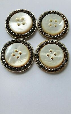 A SET OF 4 19th C  LGE 2 LAYER MOTHER OF PEARL/ CUT STEEL BORDER ON GILT BUTTONS