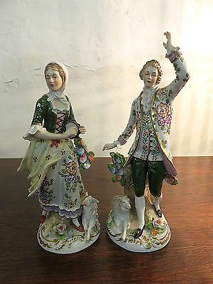 PAIR OF EARLY 1900s HAND PAINTED GERMAN PORCELAIN FIGURINES OF COUNTRY COUPLE