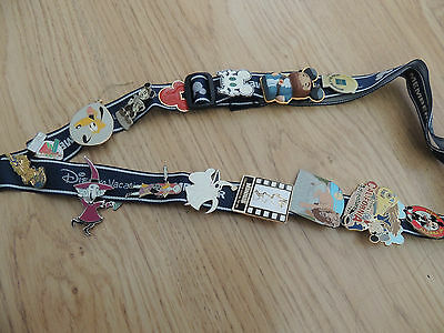 15 assorted disney pins with lanyard ideal for trading or keeping
