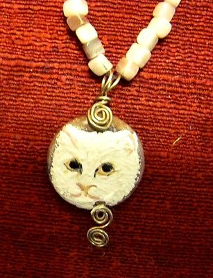 Cat, white, hand painted on a round, wire wrapped pendant/bead/necklace
