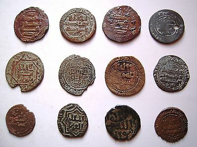 12 EARLY ISLAMIC & INDIAN BRONZE COINS. Ref. 626.
