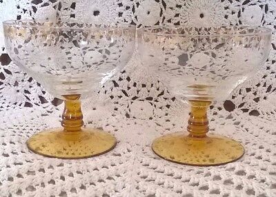 Set of 2 coupe shape sundae glasses with gold leaf motif rim and amber stem VGC