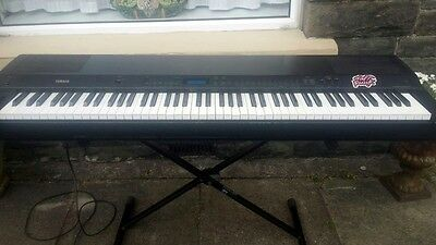 Yamaha P-150 digital piano in full working order with Quik Lok stand