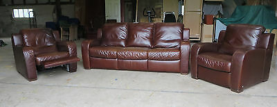 Leather three piece suite, in high grade brown leather.