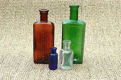 A group of 4 antique bottles poison bottles medicine Victorian