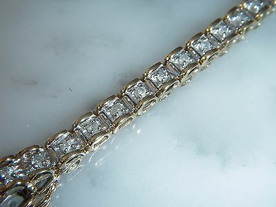 A Stunning 9 Ct Gold 1.20 Carat Diamond Bracelet And Safety Catch