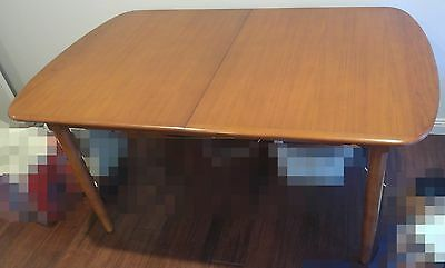 Solid wood 4 or 6 seater expandable dining table with 6 matching chairs