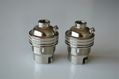 A pair of nickel bayonet fitting bulb holders B22 earthed UK made 10mm entry L1