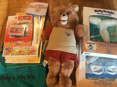 Original Teddy Ruxpin Bear with accessories -- tapes, books, adventure outfits