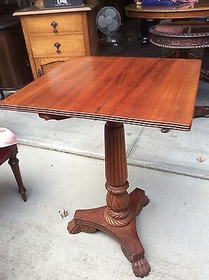 Antique pedestal carved timber with claw feet table