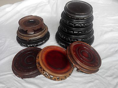 Eleven Chinese wooden vase/bowl stands