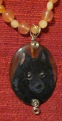 Schipperke hand painted on wire wrapped Cherry Quartz pendant/bead/necklace
