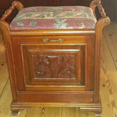 Antique piano stool with storage, beautiful carved mahogany and upholstered seat