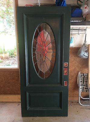 Wood Door exterior with large custom-made stained glass oval forest green white