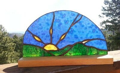 handmade Rocky Mountain Sunrise in blue, green and yellow mottled stained glass