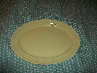 "Hazel Atlas Moderntone Platonite Oval Platter Yellow 12"" Long X 9 1/2"" Wide"