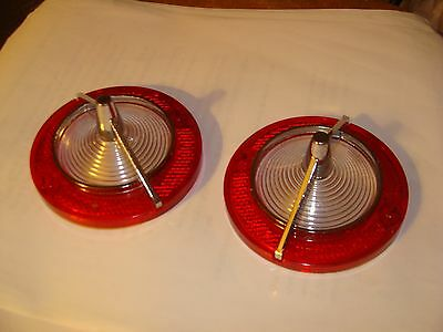 A pair of 1963 Corvair Guide back up light lenses NOS