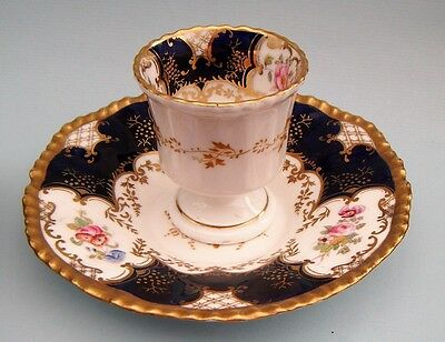 Late 19c Coalport batwing pattern egg cup and saucer. Suprb condition