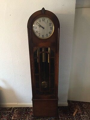 An Art Deco style grandfather clock with three weights