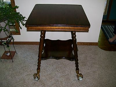 Antique Parlor Table with Huge glass ball and claw feet