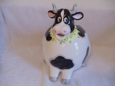 White & Black Cow Creamer/Pitcher Very Round Gal w/Yellow Flowers Around Neck
