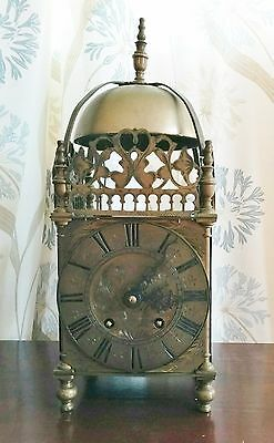 Early lantern clock with late 19th century replacement 8 day movement
